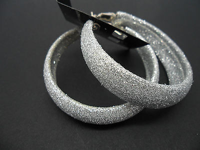 A PAIR OF  SILVER GLITTERY   LARGE 50MM HOOP  EARRINGS. NEW.