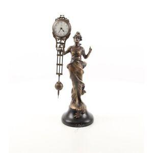 9973813-ds Bronze Skulptur Figuren-Uhr Frau Mädchen 11x14x34cm