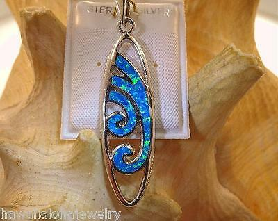 Sterling Silver Surfboard With Inlaid Paua Shell Wave Design Pendant