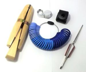 set attrezzature orafo orologiaio manipolo lente tripletta anelliera pinzetta