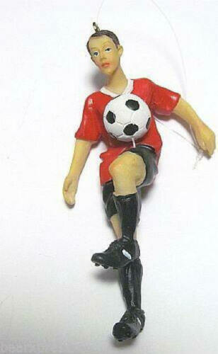 Soccer Player Suspended Ball on Knee Red Black Uniform Male Christmas Ornament