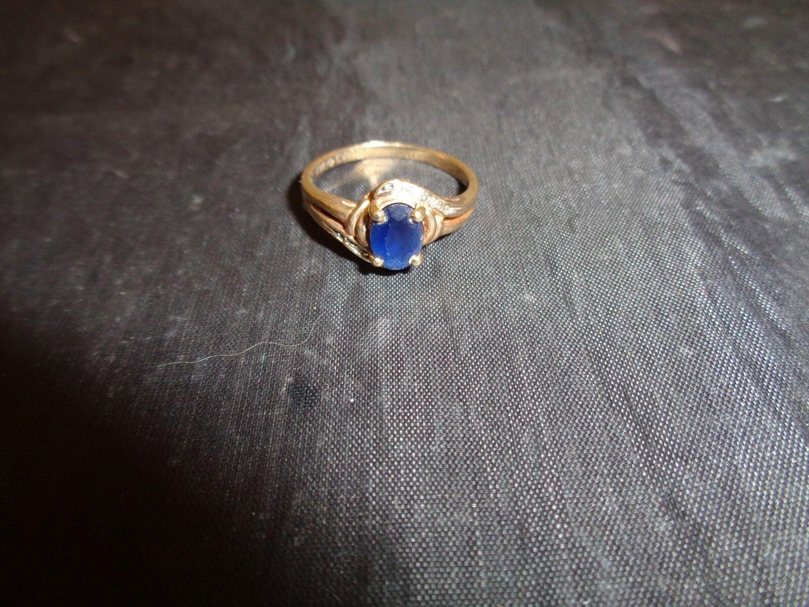 10K Ladies Ring Size 7.5  gold 2.4 Grams Dark bluee Stone
