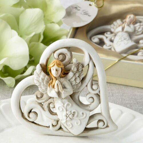 Churches Ministries magnificent heart statue with raised praying angel
