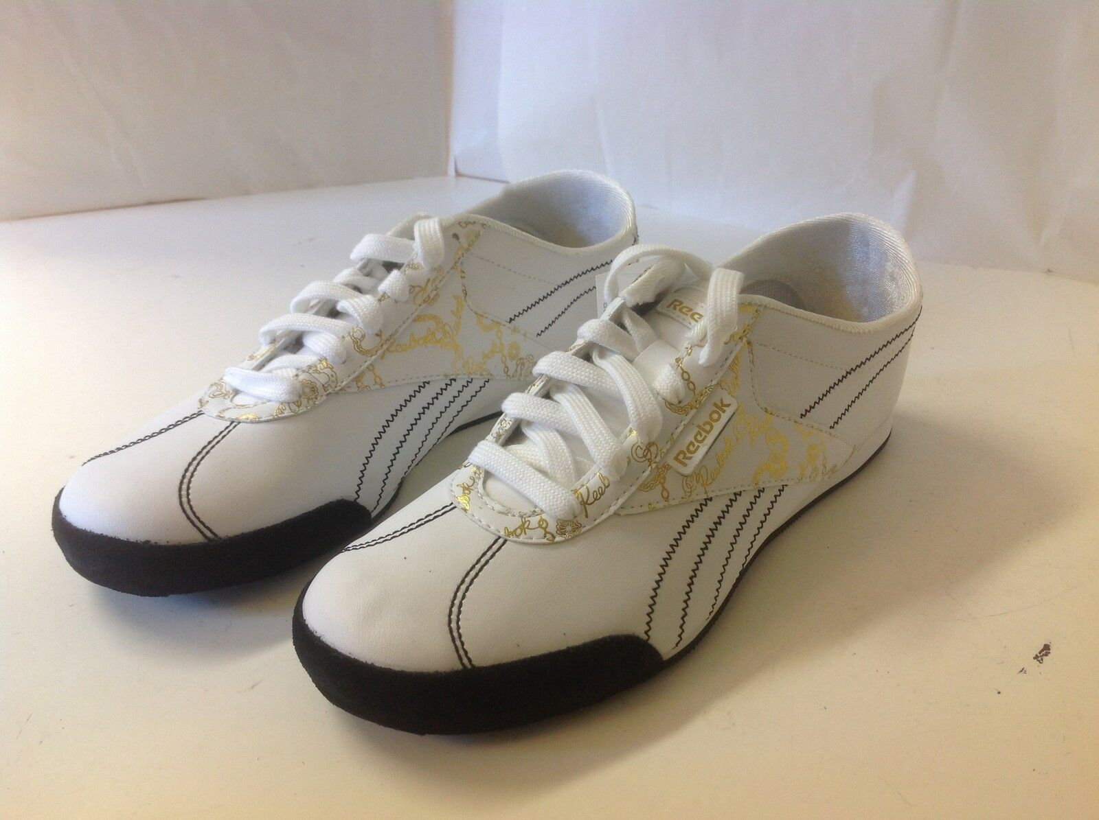 REEBOK Temptra Spyce Pack White Leather Casual 9 1/2 M Shoe New Black Gold Trim