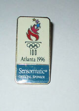 Pin's Jeux olympiques Atlanta 96 - sponsor officiel Sensormatic (zamac h: 3,9cm)