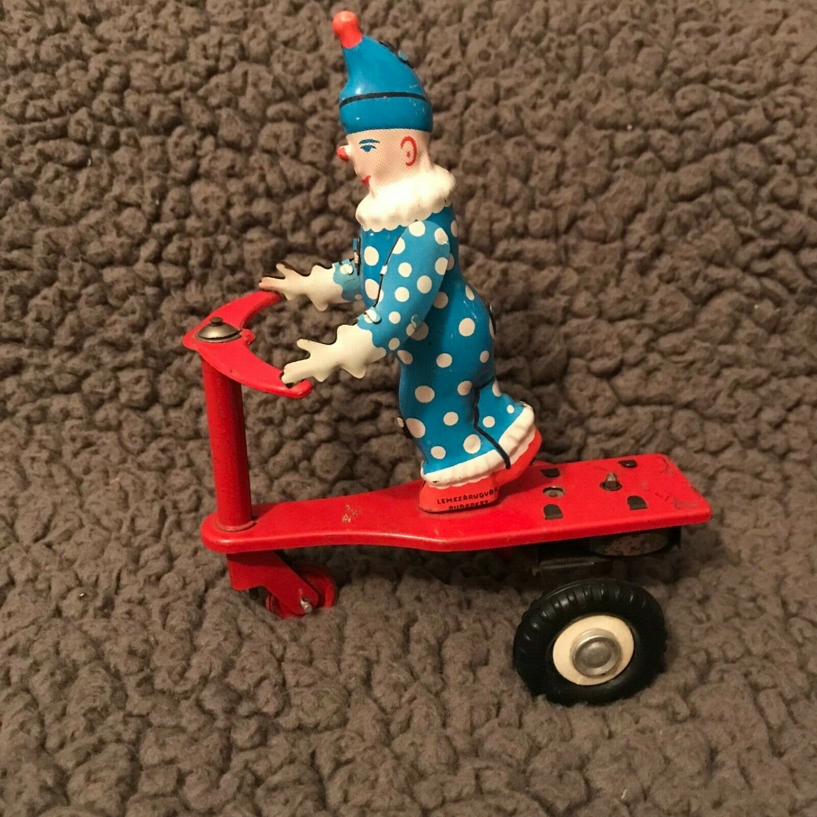 Vintage Rare Metal Tin Toy Clown on Scooter  Antique