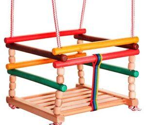 Wooden-baby-swing-is-very-solid-door-frame-indoor-or-outdoor-garden-tree-safety