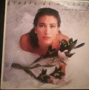 GRAZIA DI MICHELE - L'AMORE è UN PERICOLO*ANNO 1988-DISCO VINILE 33 GIRI* N.69
