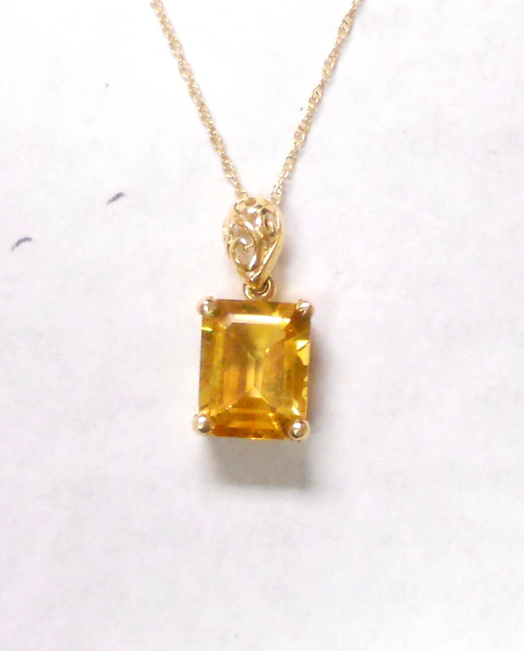 Estate 10k Solid gold Citrine Pendant on a 10K Solid gold 18 inch Chain.