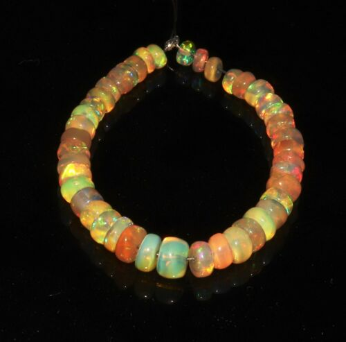 Details about  /12.31 TCW NATURAL ETHIOPIAN WELO FIRE OPAL  ROUNDEL BEADS DEMI STRAND S6338