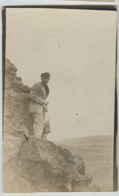 1912 Hatton Washington Man with camera on rock ledge Real Photo Postcard RPPC