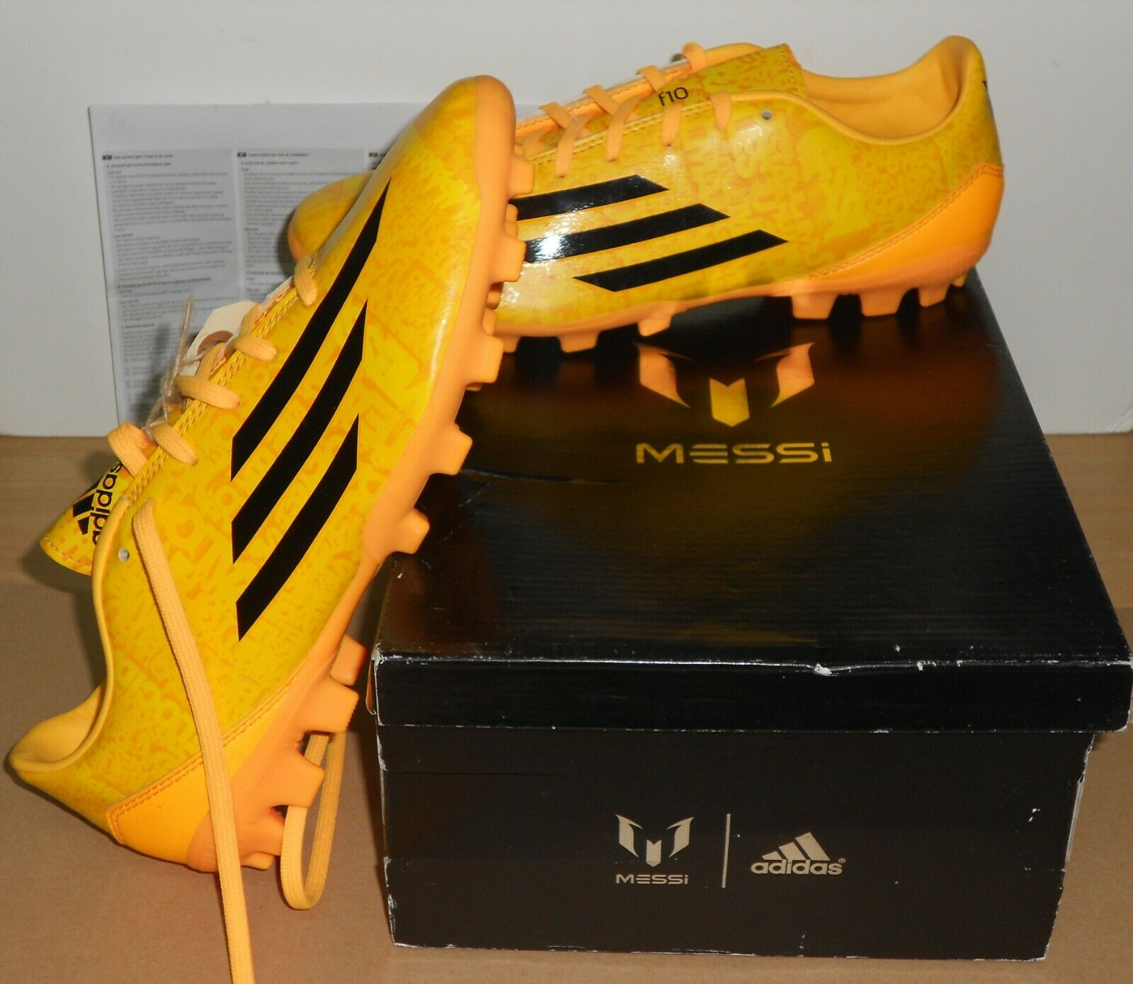 82f826368 Mens adidas F10 AG messi M25014 Football BOOTS shoes Artificial Grass
