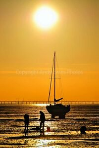 Sunset-over-a-boat-in-Thorpe-Bay-Southend-Essex-photograph-picture-poster-print