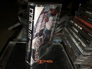 SEALED-OUTLAWZ-CASSETTE-TAPE-RIDE-WITH-UP-OR-DIR-FOR-US-2PAC-NEW-UNOPENED-LOOK