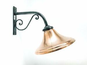 Lampada da parete in ferro battuto con parabola in rame da interno