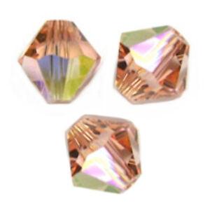 10-Perles-Toupies-3mm-cristal-Swarovski-LIGHT-PEACH-AB