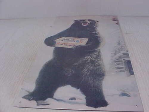 Black Shells Bear holding case of shells sign  #21