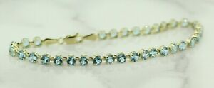 9ct-Yellow-Gold-Blue-Topaz-Tennis-Bracelet-8-Inches