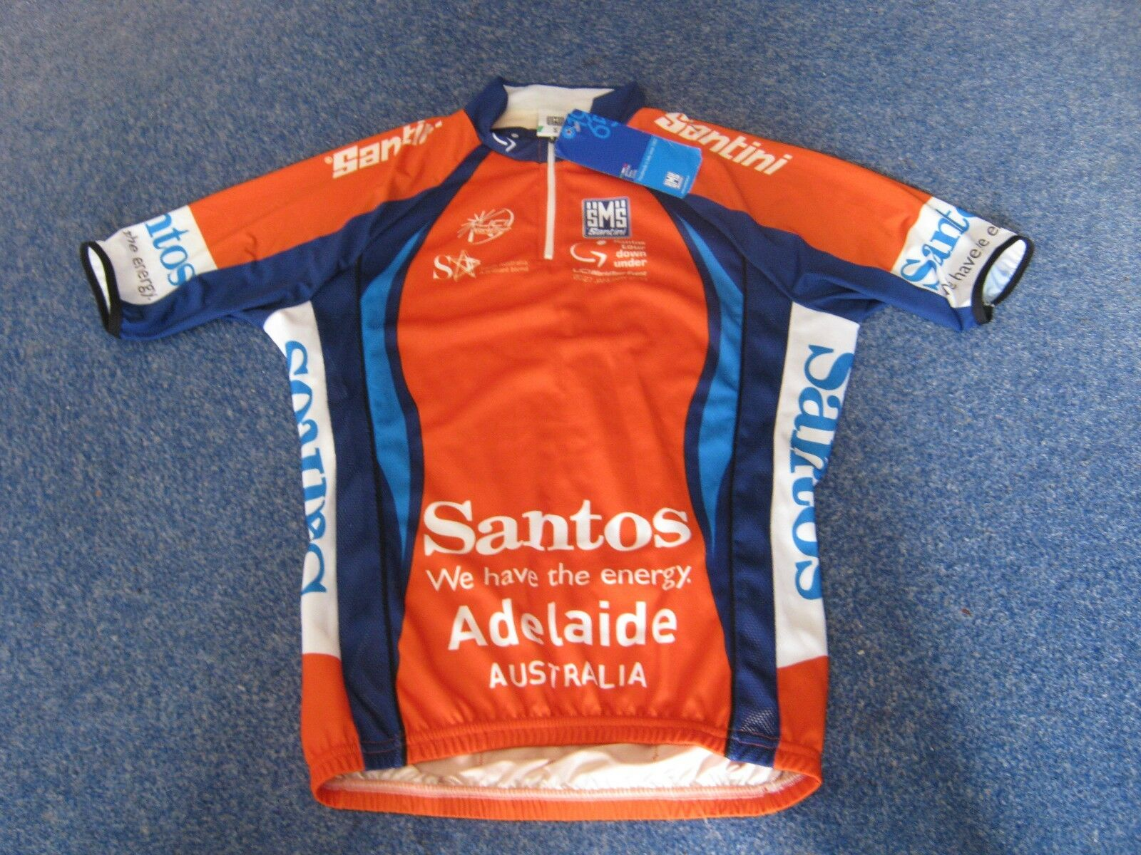 SANTOS TOUR DOWN UNDER SANTINI 2013 LEADERS Orange CYCLING JERSEY  BNWT