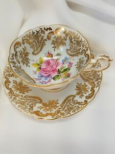 Paragon-pale-blue-white-tea-cup-saucer-gold-gilt-cabbage-rose-double-warrant