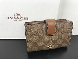 8effed0bd4a32 NWT Coach Signature Logo PVC Medium Corner Zip Wallet khaki Saddle ...