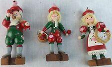 Christmas ornament red green wooden figures yarn hair blond 2 girls 1 boy