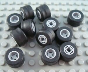 LEGO Lot of 8 Black 2x2 Axle Plates with Light Bluish Smooth Wheel Hubs