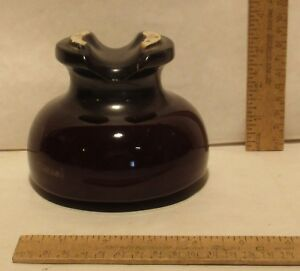 Brown Ceramic Insulator Marked With A