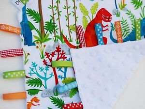 Taggie Blanket bright dinosaurs with white dimple minky backing