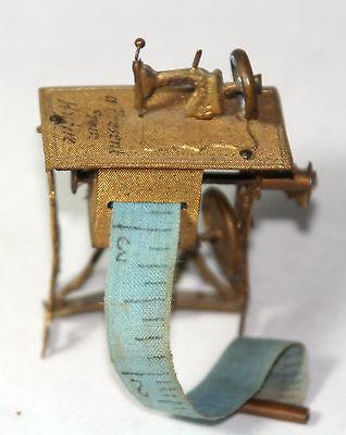 ANTIQUEc 1800's~~wind-up SEWING MACHINE & stand TAPE MEASURE~~ FIGURAL,METAL