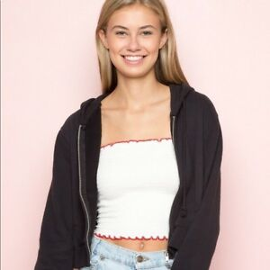 f0b259841f1 Brandy Melville white ruffle smocked cleo tube top with red trimming ...