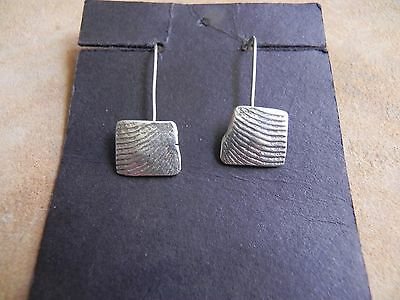Sterling Silver dangle Earrings with textured design signed R Navajo