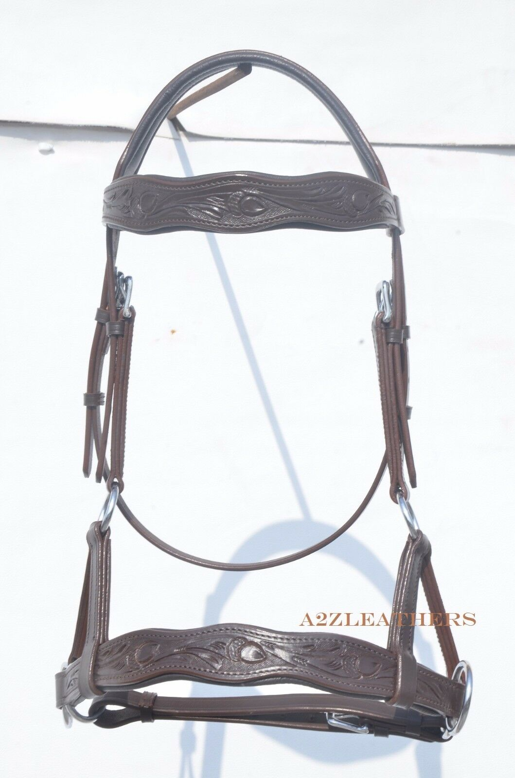 Brown sidepull bitless bridle with hand carving on Curve shape brow & noseband..