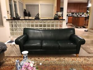 Details about Two identical designer emerald green leather sofas in very  good condition