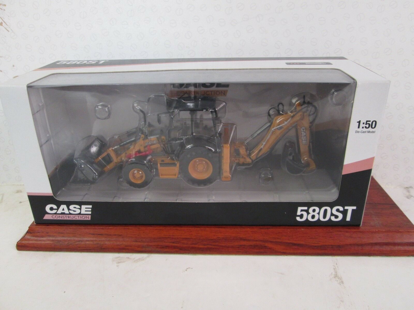 UNIVERSAL HOBBIES. Case 580 ST. Front Shovel and Back Hoe. 1 50. Yellow. UH 8079