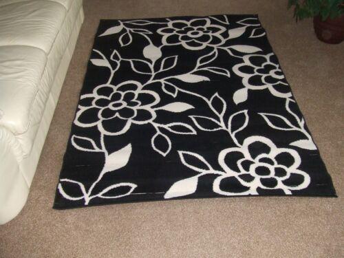 Black and cream floral rugs 135cm x 190 cm