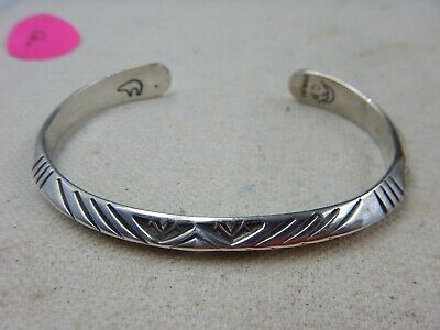 Lot 5596 Vintage Matched Pair of Signed Southwest Coin Silver Stamped Cuff Bracelets....