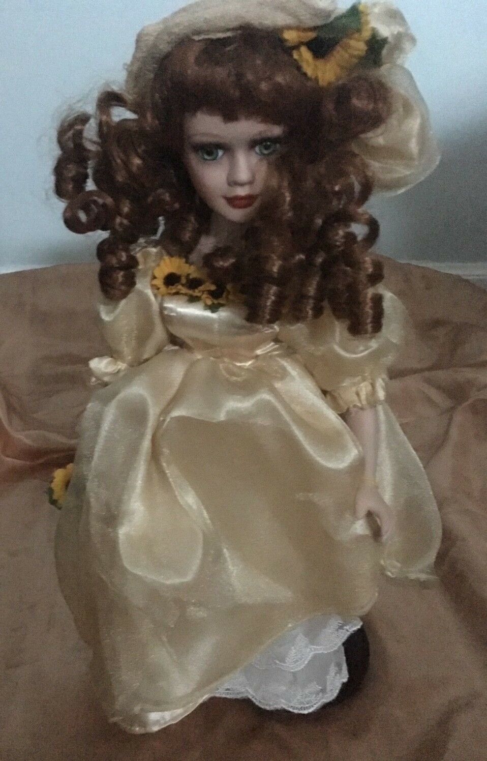 Porcelain doll rojo Hair amarillo dress Sunflowers in hand