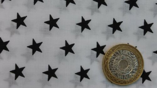 2 fat quarters of polycotton with small black stars on white