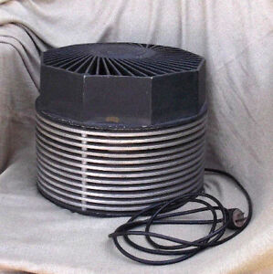 Post World War II Era Mid Century Modern Floor Fan Vintage Circular Motionair