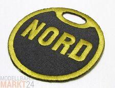 """Aufnäher Flicken """"Nord"""" gesticktes Logo in schwarz-gold  Maße ca. 5,9 x 5,9 cm"""