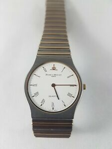 Baume Mercier 18k gold and stainless  watch , works good