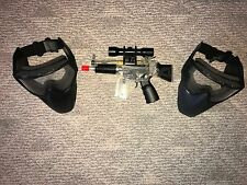 Airsoft masks with automatic gun