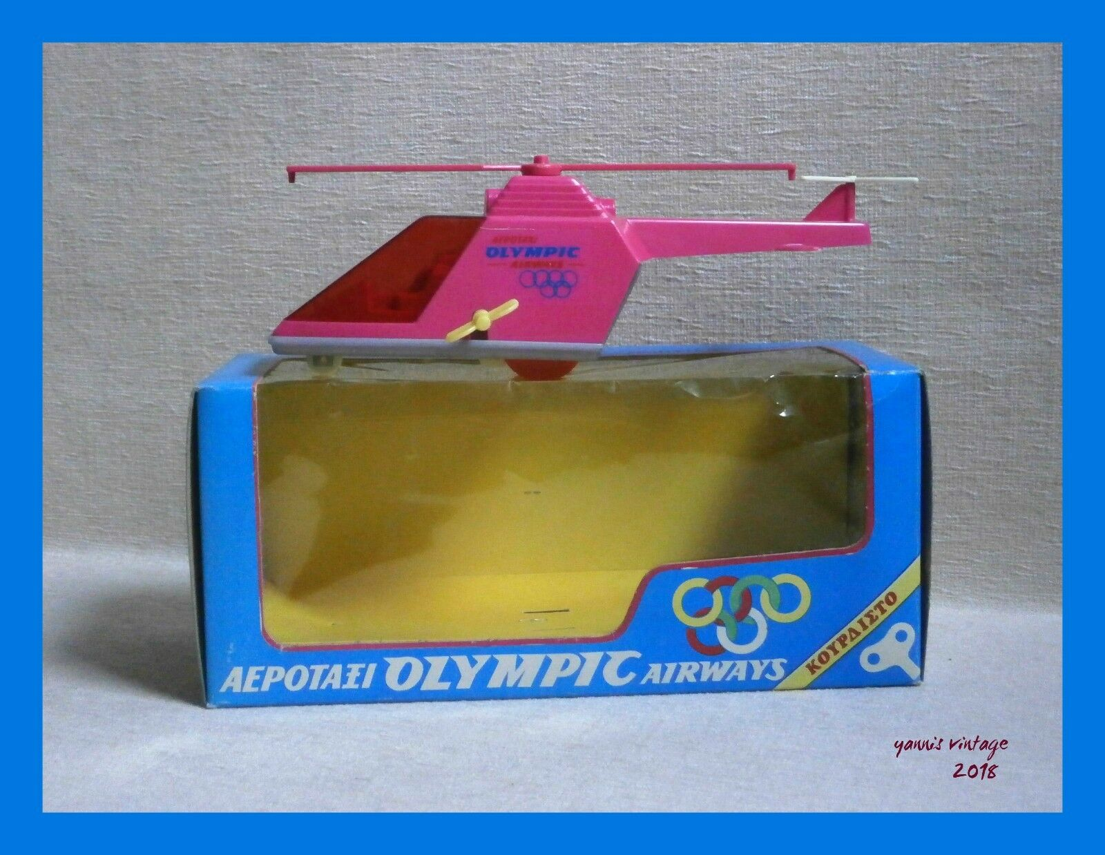 AERO-TAXI   HELICOPTER OLYMPIC AIRWAYS NIB Wind up Greece anco toys Fuchsia