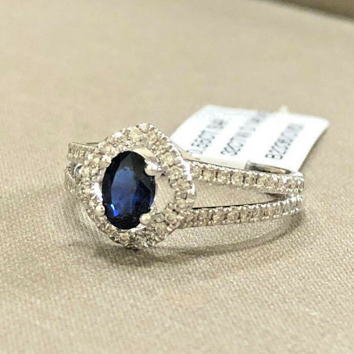14K White gold 0.55 ct. Oval bluee Sapphire in Diamond Halo Split Shank Ring