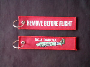 Canberra on front Remove Before Flight on reverse Cloth Keyring