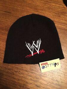 Image is loading WWE-logo-winter-cap-black-mens-boys-hat 61cb8a8b7d1