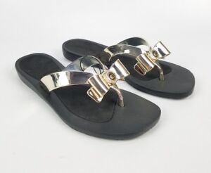 da6fac2f0171f5 G by Guess Black And Gold Bow Flip Flops Size 5 New Without Box