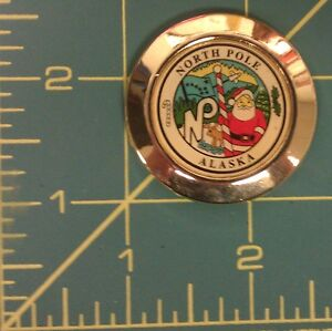Alaska-Magnet-with-North-Pole-City-Seal-is-pictured-with-Santa-North-Pole-AK