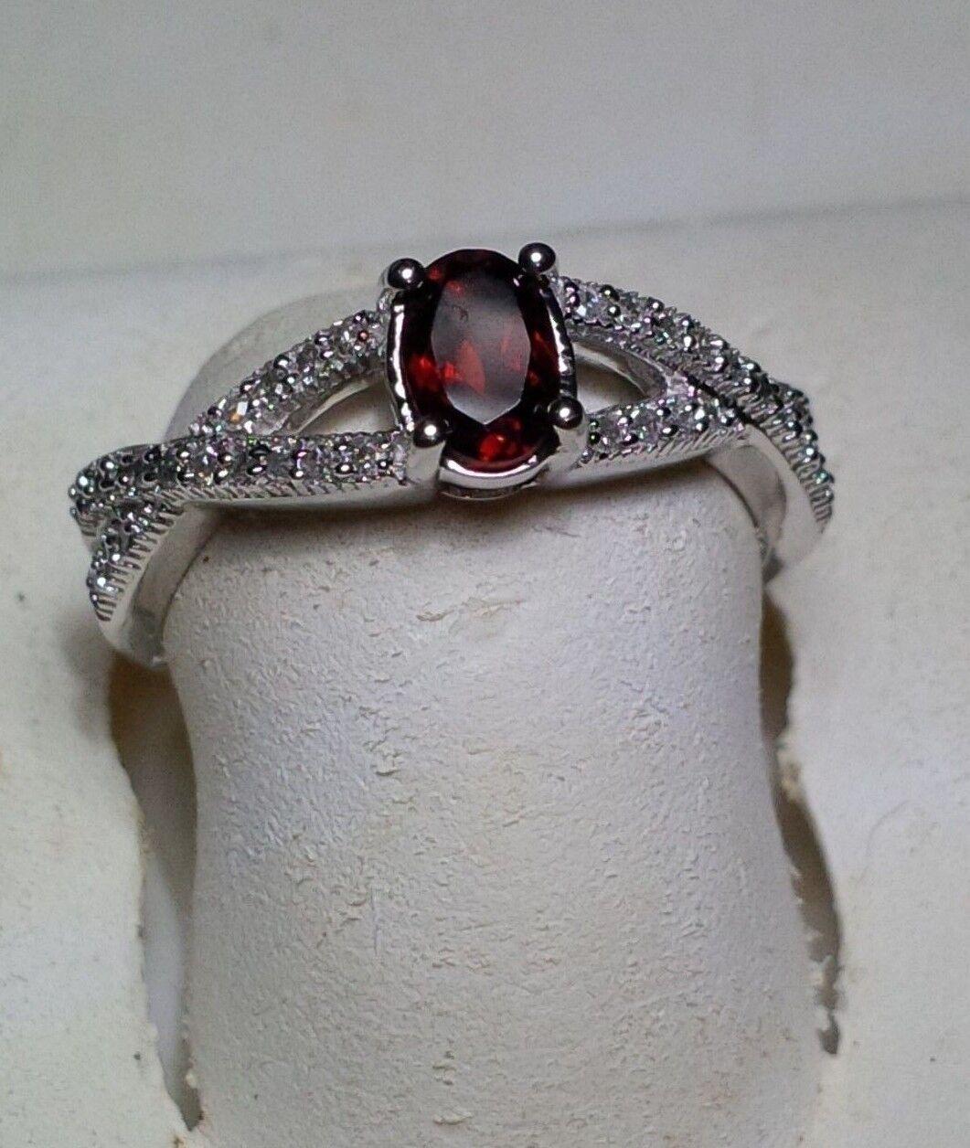 .18cttw Diamond & Oval Garnet X design shank Modern 10KT White gold Ring